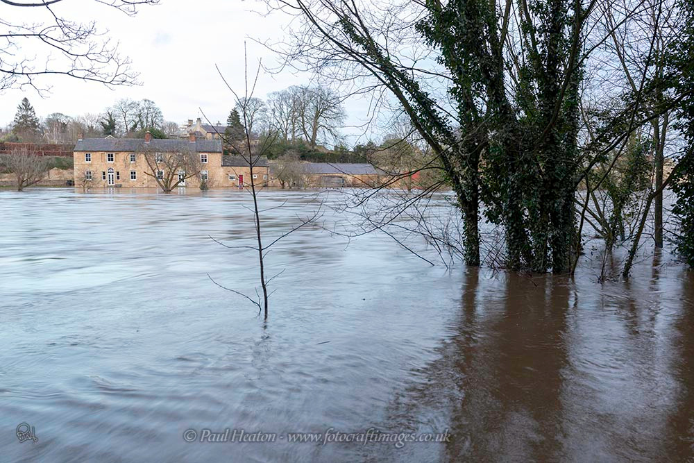 River Wharfe in flood flowing through Boston Spa in West Yorkshire